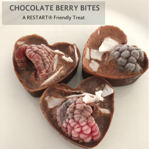 A Beautiful Dessert or Gift for Your Sweetheart (or You!) This recipe was created for Lori's RESTART®️ participants because she knew it could be a challenge to eliminate sugar, but how beneficial it is to go through this journey. These creative not sweet treats would make a beautiful gift or dessert for anyone, with good fats from coconut oil and almond butter, antioxidant benefits from cacao and berries and flair from add-ins such as coconut flakes, coconut butter or nuts.